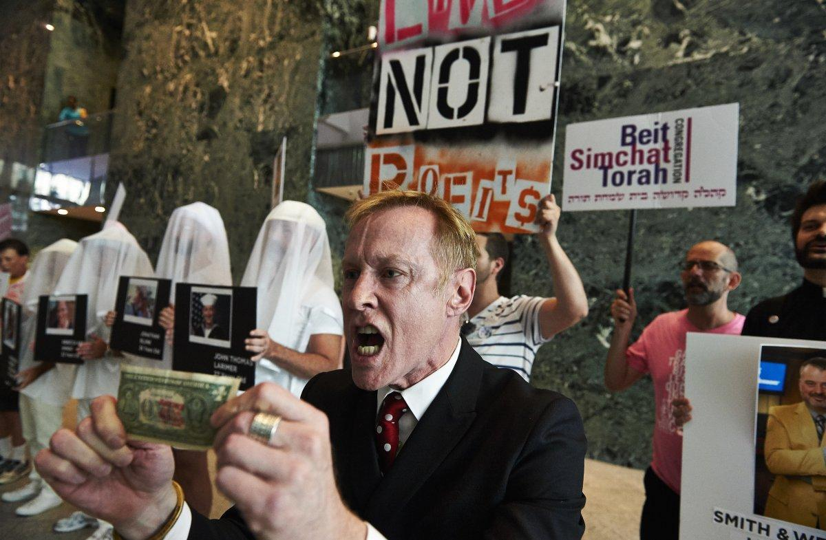 """Gays Against Gun member Ken Kidd leads protesters in a """"blood money"""" chant at BlackRock's midtown Manhattan headquarters (Photo credit: James Keivom, New York Daily News)"""
