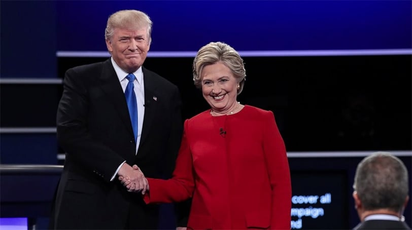 Presidential candidates Donald Trump and Hillary Clinton shake hands as they take the stage of the first of three presidential debates scheduled before the November election. (Photo: Getty Images)