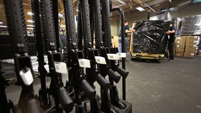 A rack of AR-15 rifles stand to be individually packaged as workers move a pallet of rifles for shipment at the Stag Arms company in New Britain, Conn., Wednesday, April 10, 2013. (Photo: Associated Press)