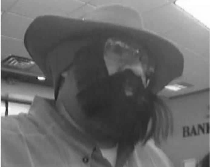 """Albuquerque, New Mexico. October 15, 2012. The suspect wore a green plaid long-sleeved shirt, a tan wide-brim hat, clear glasses, and a bushy black beard that """"may"""" have been fake."""