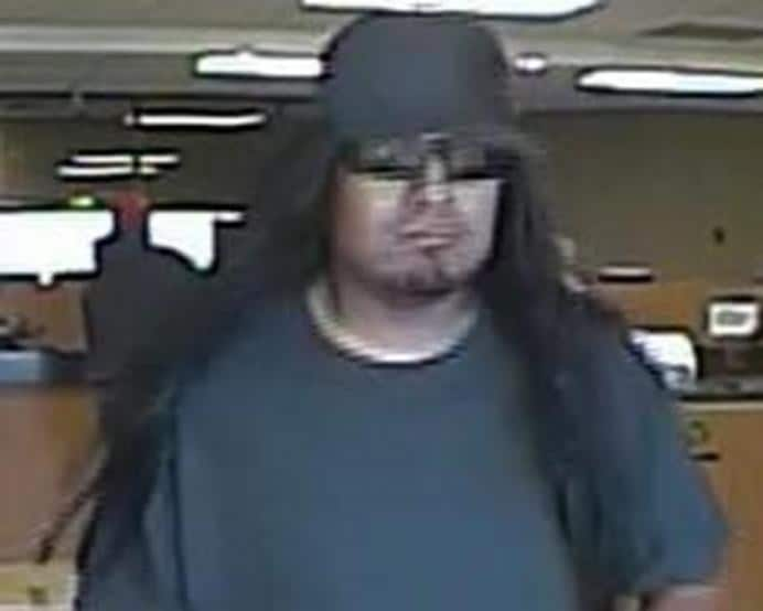 What's up with Albuquerque? This one did back to back robberies on October 3, 2014 and October 4, 2014. The suspect wore a black baseball cap, sunglasses, a long black wig, a black t-shirt, blue jeans, and sneakers. He carried a black cloth bag and had a small amount of facial hair on his chin.