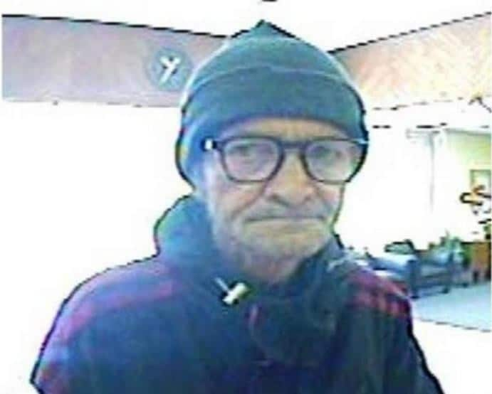 Carlsbad, New Mexico. December 13, 2012. The suspect wore black-rimmed glasses, a dark jacket and a green stocking cap. He was unshaven.