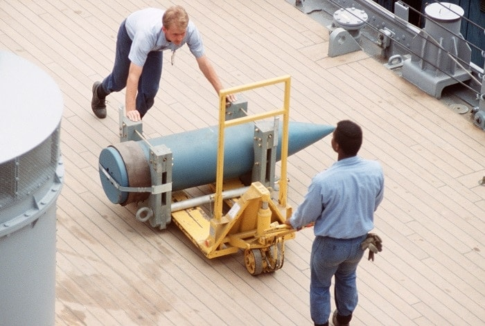 Crewmen load a 16-inch shell aboard the battleship USS WISCONSIN (BB 64) as the vessel is readied for sea trials (Photo: National Archives)