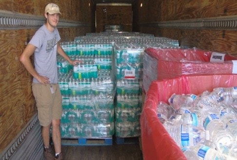 A Daniel Defense employee prepares to hand out free water to Georgia residents impacted by Hurricane Matthew. (Photo: WTOC)