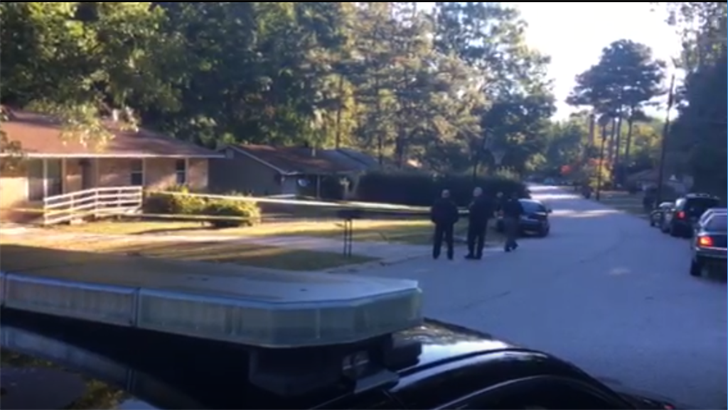 Police are collecting evidence and talking to neighbors to determine why an unknown number of home invaders shot and killed two children inside their home. (Photo: WGCL)