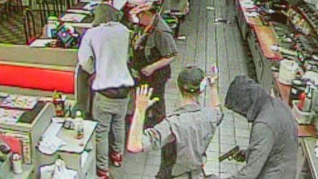 The Coweta County Sheriff's Office reported one suspect placed a gun in the cook's back and demanded her wallet, while a server opened the cash register. (Photo: CCSO via The Newnan-Times Herald)
