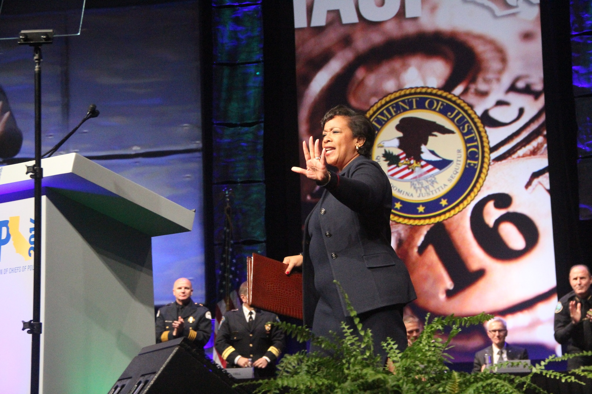 U.S. Attorney General Loretta Lynch waves to a crowd of several thousand law enforcement professionals and others as she takes the podium during the National Association of Police Chiefs annual convention in San Diego Oct. 15-18, 2015. (Photo: Jared Morgan / Guns.com)