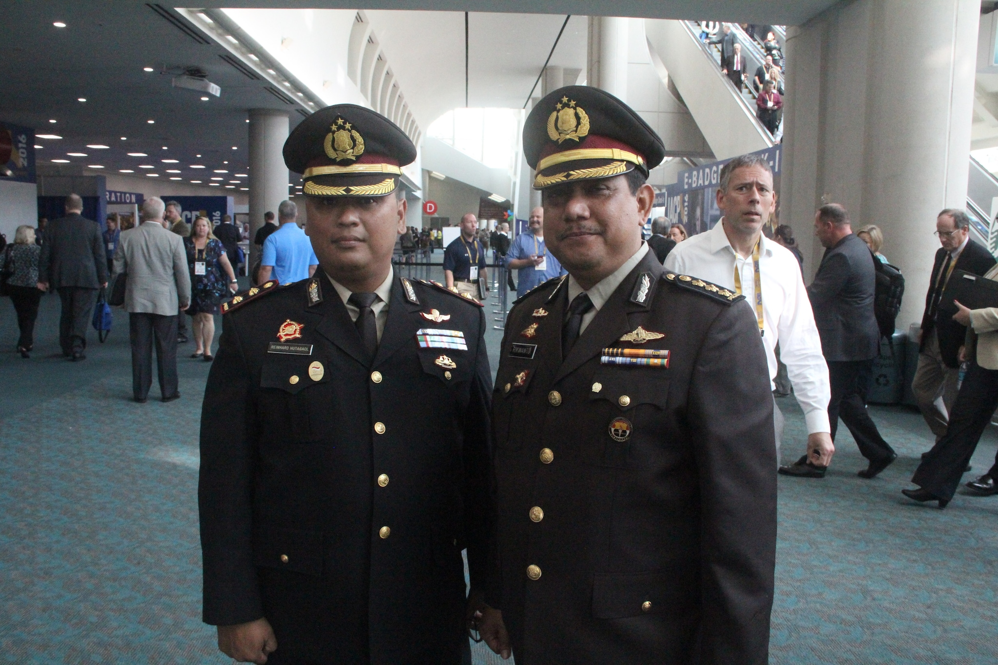 Two Indonesia police officers pose for a photo on Uniform Day during the National Association of Police Chiefs annual convention in San Diego Oct. 15-18, 2015. (Photo: Jared Morgan / Guns.com)
