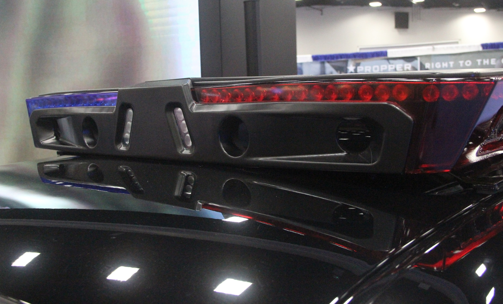 Ekin displays a smart lightbar system on a police cruiser during the National Association of Police Chiefs annual convention in San Diego Oct. 15-18, 2015. (Photo: Jared Morgan / Guns.com)
