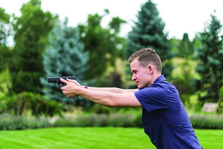 Kai Kloepfer demonstrates how to grip the Biofire Technologies smart gun. (Photo: Matt Nager/ Wall Street Journal)