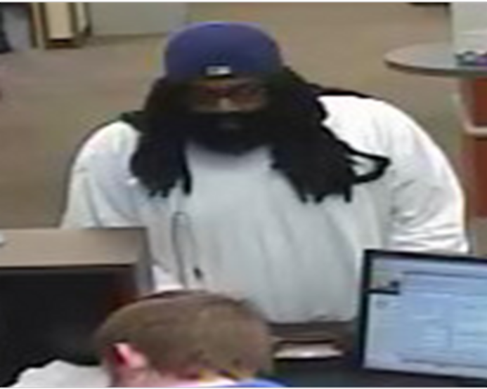 Little Rock, Arkansas. May 31, 2013; September 6, 2011. In the robbery of the Metropolitan Bank, the suspect wore black prescription-like glasses; a full solid black beard (possibly fake); black dread-locks that hang down to the middle of his back (possibly fake); a solid white, plain, long-sleeved tee shirt; and a solid blue baseball cap (worn backwards). In the robbery of the Arvest Bank, the suspect wore sunglasses, fully bushy beard (possibly fake), a white shirt, tan pants, brown hat, and white tennis shoes.