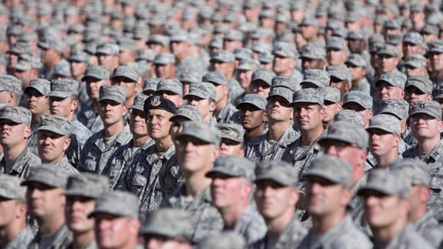 Soldiers in the California National Guard look on in disbelief when they're told they were overpaid $15,000 a piece. (Photo: DoD)