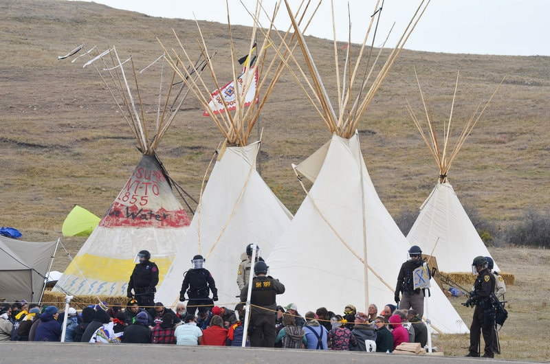 Law enforcement decked out in riot gear moved in on protestors rallying against the Dakota Access pipeline. (Photo: Amy Sisk/Prairie Public Broadcasting)