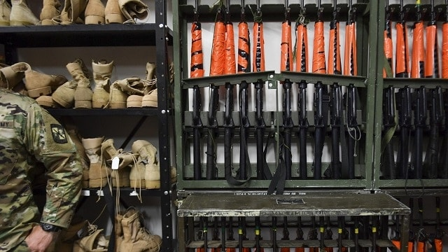 Just to make sure nobody gets the wrong idea: replica rifles at an ROTC unit at George Mason University have gotten the sticky orange tape treatment. (Photo: Ricky Carioti/The Washington Post)