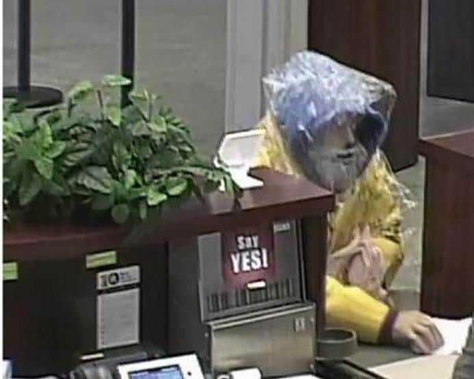 In 2015, this man robbed banks in Sacramento and Carmichael, California some six months apart. At the time of the June 10, 2015, robbery, the suspect wore a yellow rain jacket, blue hoodie and a clear poncho over his clothes. He also wore boots that seemed too large for him. At the time of the December 3, 2015, robbery, the suspect wore an orange rain poncho over dark clothes. He also wore sunglasses and a fake beard.