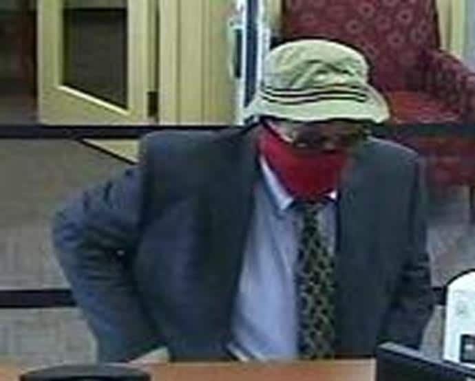"""For when you have to make a quick stop to pick up some cash between work and the lake.The subject in this 2015 Dresher, Pennsylvania robbery is described as a White male, 50 to 60 years of age, 5'11"""" to 6'1"""" tall, medium to heavy build, wearing a blue business suit, a blue button-down dress shirt and a patterned tie, a light-colored """"bucket"""" style hat, dark sunglasses, a red scarf over his nose and mouth, and white rubber gloves."""
