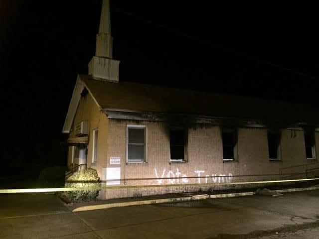 vote trump spraypainted on church