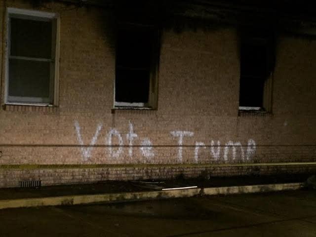 black church spraypainted graffiti