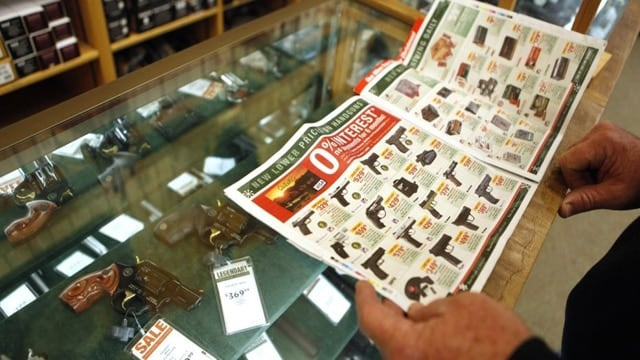 A customer looks through the in-store sales advertisements in Fort Worth, Texas on Nov. 27, 2009. (Photo: Jessica Rinaldi/ Reuters)