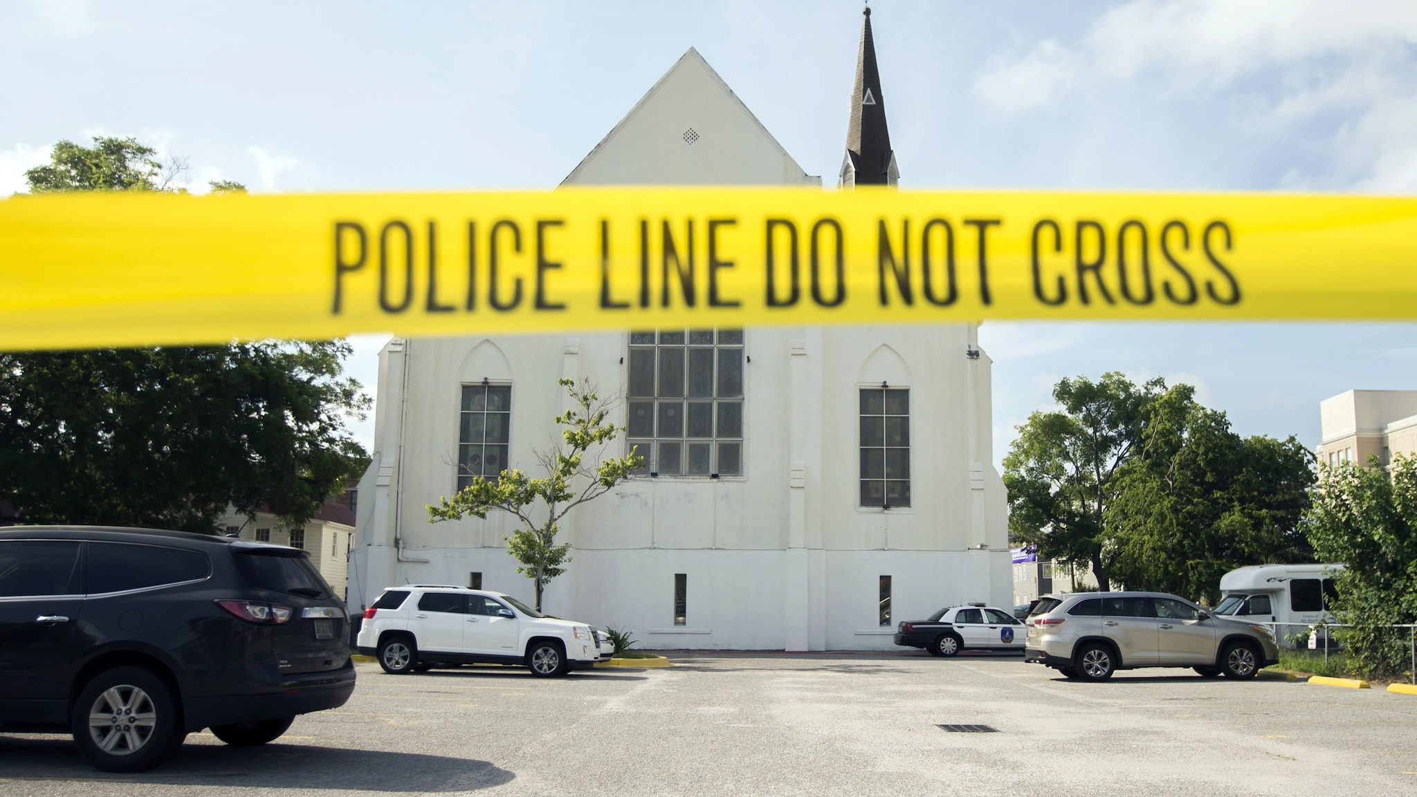 Police tape surrounds the parking lot behind the AME Emanuel Church as FBI forensic experts work the crime scene, Friday, June 19, 2015 in Charleston, S.C. (Photo: Stephen B. Morton/AP Photo)