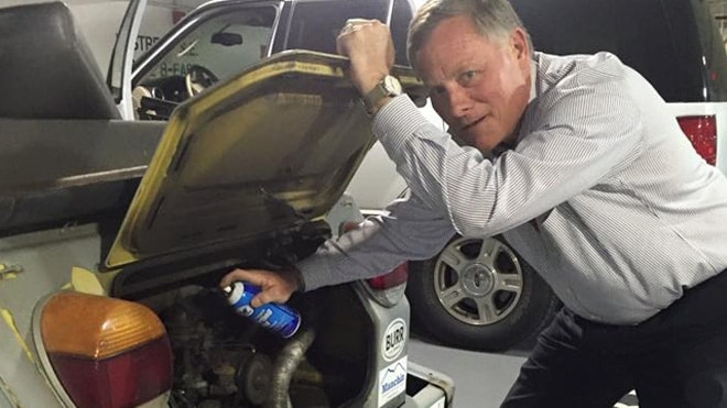Sen. Richard Burr, a Republican from North Carolina, applying some kind lubricant to a vehicle. (Photo: Burr/Facebook)