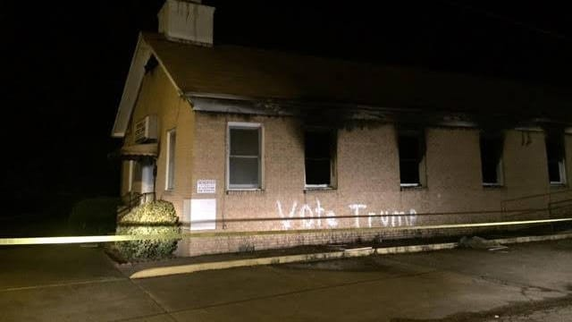 """The Hopewell Baptist Church after the fire. Vandals allegedly wrote """"Vote Trump"""" on the side in spray paint. (Photo: Hopewell Baptist Church)"""
