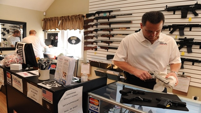 Dennis Pratte, owner of a gun store in Falls Church, Va., told The New York Times he sells weapons only to buyers who clear a background check (Photo: Mary F. Calvert/The New York Times)