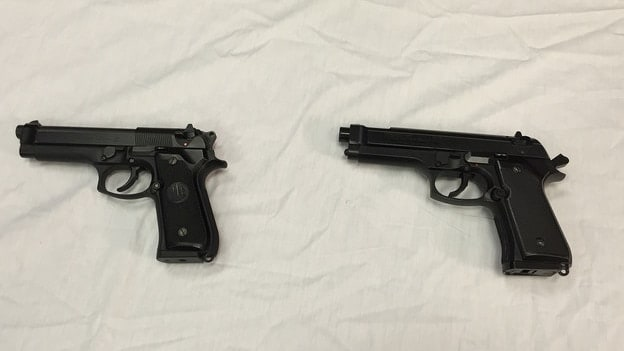 Police display Colvin's replica gun, right, next to a semi-automatic handgun, pictured left. (Photo: Juliet Linderman/AP)
