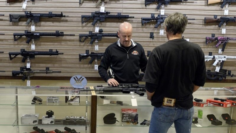 A customer looks at rifles at a Colorado gun shop in this January 2016 file photo (Photo: Andy Cross/Denver Post)