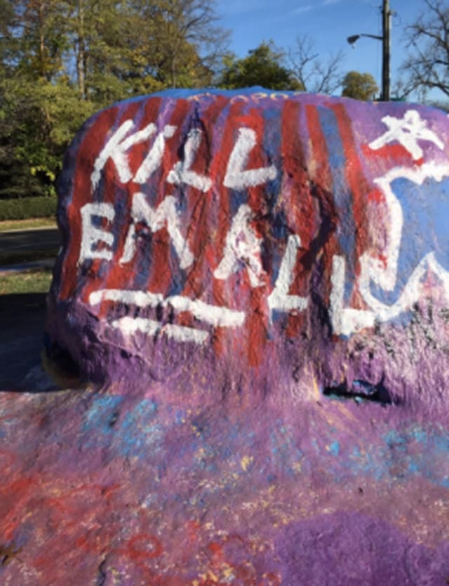 kill em all painted on rock