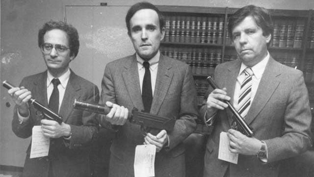 Rudy Giuliani, center, poses with a machine gun in this 1989 photo. (Photo: Michael Schwartz/New York Post Archives / (c) NYP Holdings, Inc. via Getty Images)
