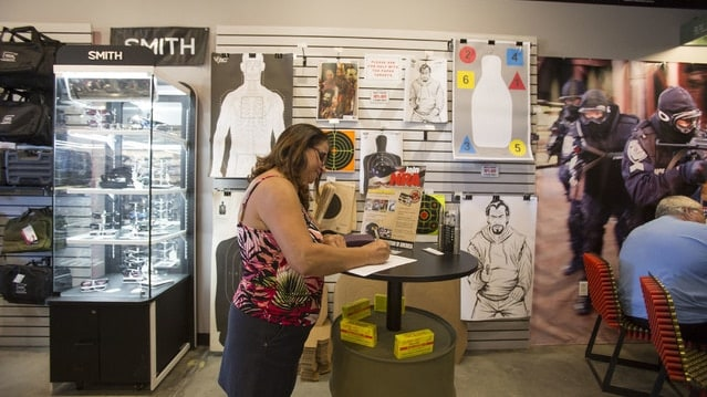 A woman fills out a background check form at Westside Armory in Las Vegas (Photo: Richard Brian/Las Vegas Review-Journal)