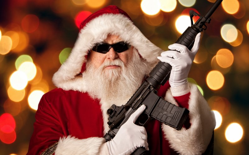 Santa's packing more than just toys in his gift bag. (Photo: Getty)