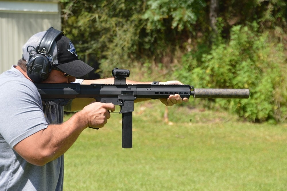 Though with the SBR being six inches shorter, the difference in length with a can attached is stark