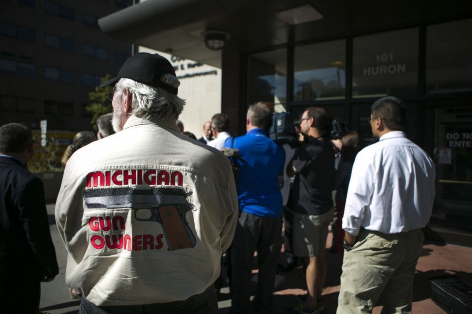 Mike Thiede of Michigan Gun Owners looks on at a press conference in September regarding guns in schools. (Photo: Dominic Valente /The Ann Arbor News)