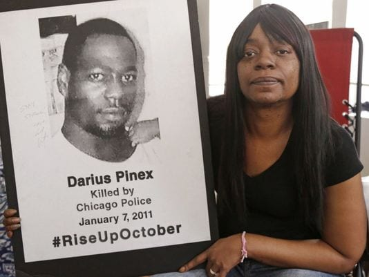 Gloria Pinex holds the photo of her son Darius Pinex, 27, who was fatally shot by police in 2011. (Photo: M. Spencer Green/AP)