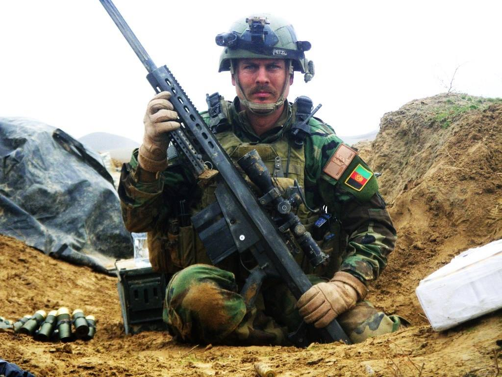 Marine sniper Mark Terrell on Pathfinder Hill on 28 December 2009 with his M107 rifle after it had been hit by an enemy PKM machine gun round (Photos: National Museum of the Marine Corps)
