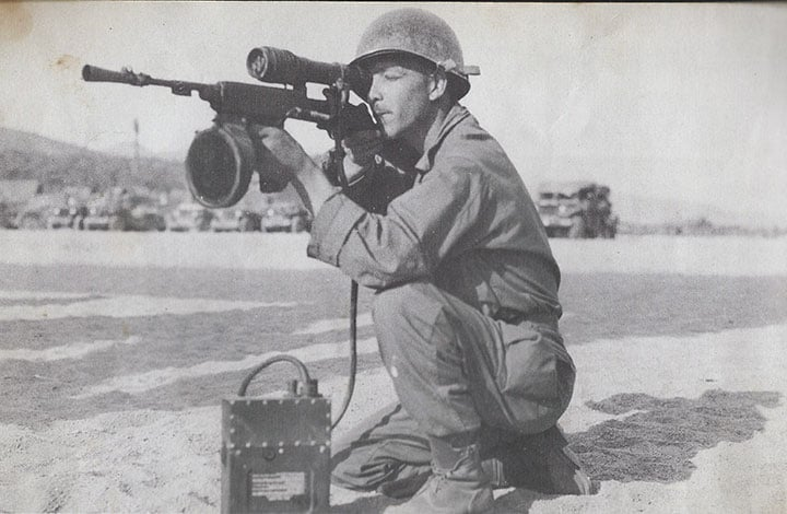 The M3 Carbine at use-- the gun that the T3 evolved into. The scope and lamp fitted were extremely bulky but proved to be effective out past 100 yards at night. (Photo: U.S. Army)