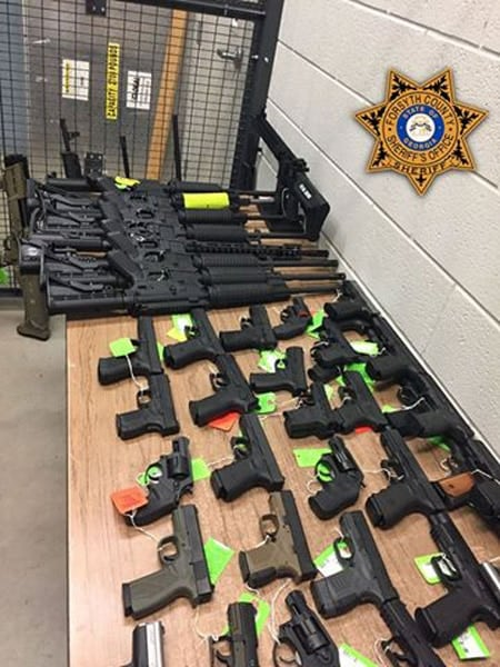 stolen guns laid out on table