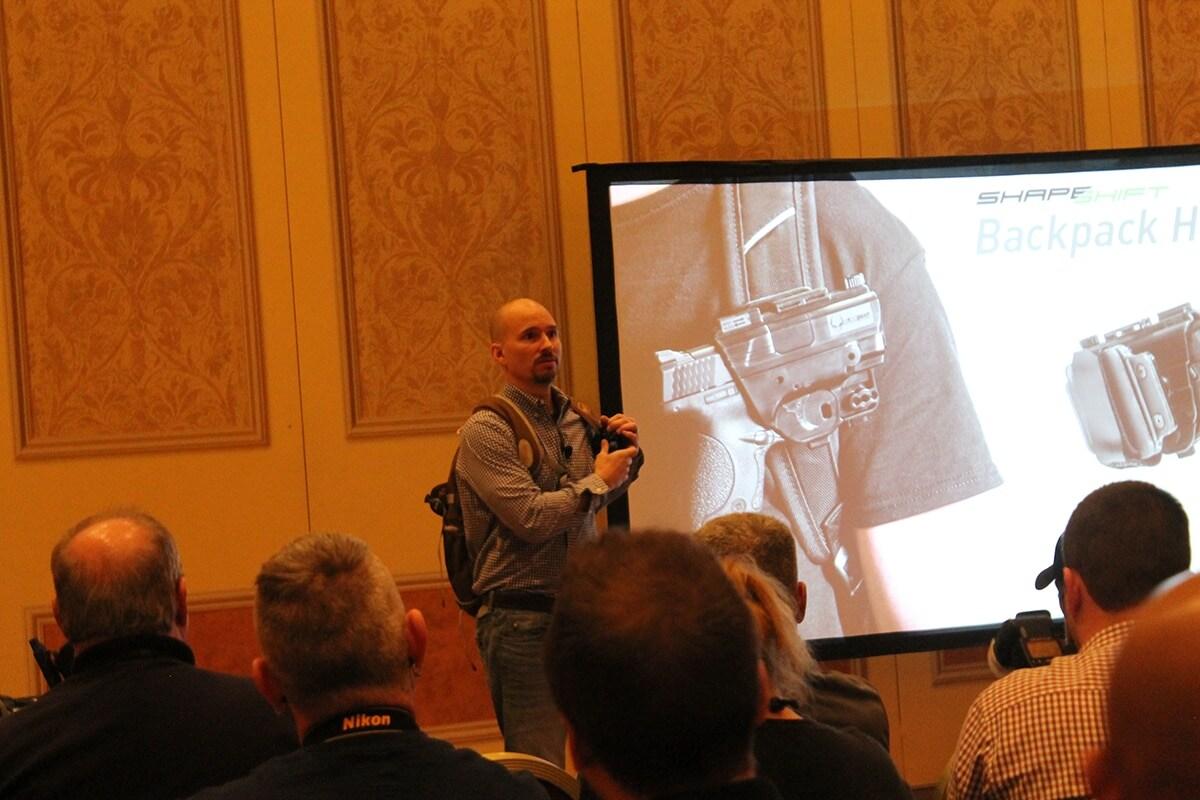 The owner of Alien Gear, Thomas Tedder, demonstrating the backpack rig. (Photo: Jacki Billings)