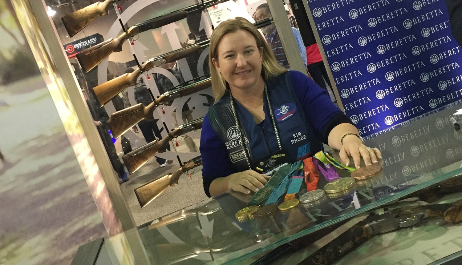 Six-time Olympic medal winner Kim Rhode appeared at the Beretta booth for a meet and greet with fans. In her display case sits the Beretta DT11 shotgun, the gun used to win 10 of 15 medals at the summer Olympic games. (Photo: Daniel Terrill/Guns.com)