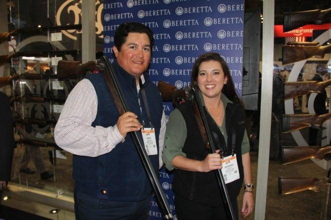 Beretta's Zach Kienbaum, left, and Desi Edmunds sport the company's DT11 standard and L models, respectively. It's a premium target gun with steelium pro barrels. (Photo: Jared Morgan/Guns.com)