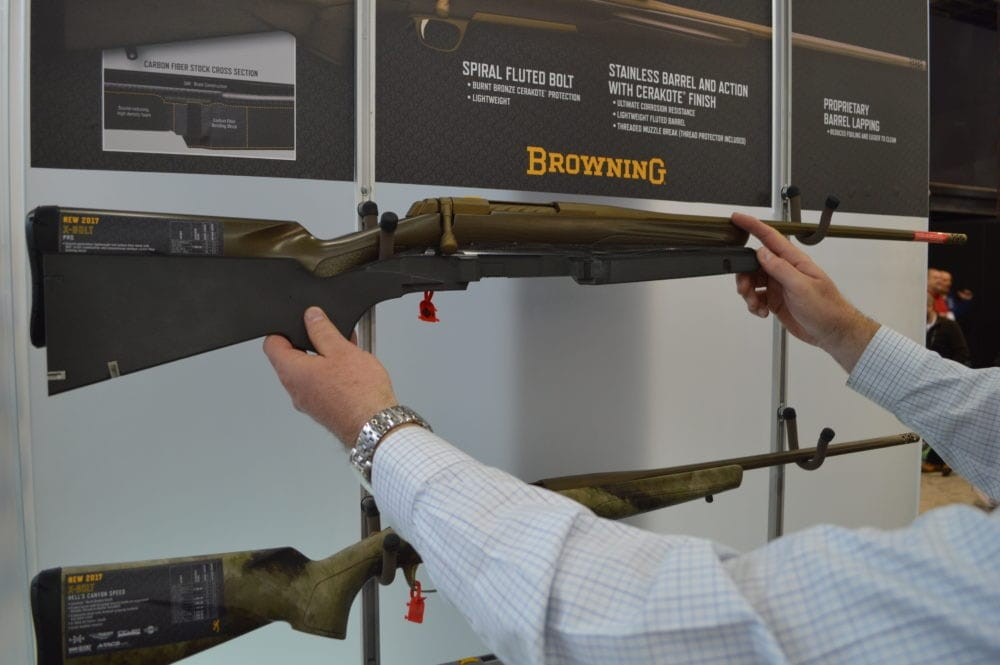 Browning's new-for-2017 bronze-cerakoted X-Bolt rifle comes chambered in 6.5 Creedmoor. A company rep shows off a cutaway of this model's carbon fiber stock. (Photo: Kristin Alberts)