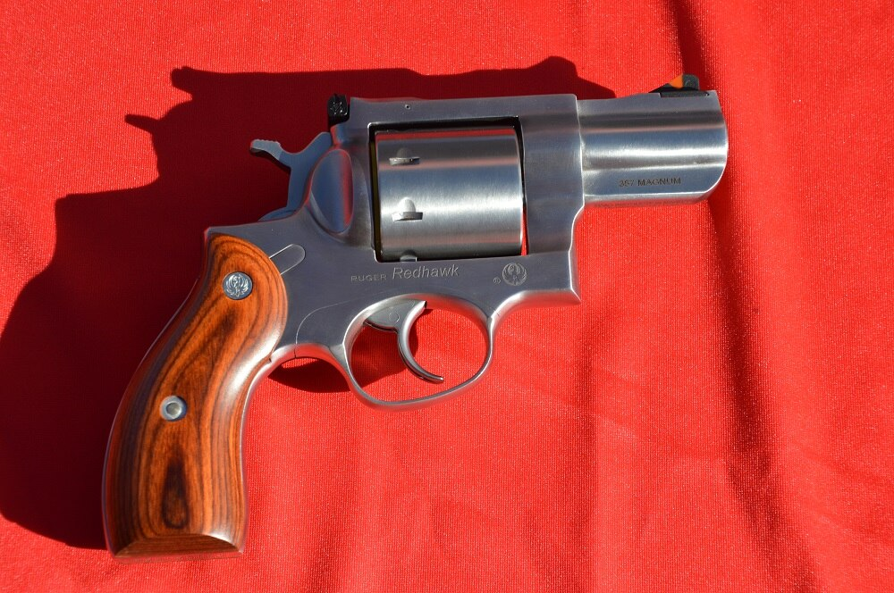 With a rounded butt and Altamont hardwood grips the gun is very distinctive before you note the unfluted cylinder.
