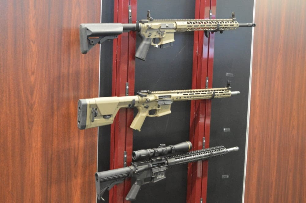 Nosler displayed full rifles in 22 Nosler from not only Colt, but also these three from Noveske, and Stoner. (Photo: Kristin Alberts)