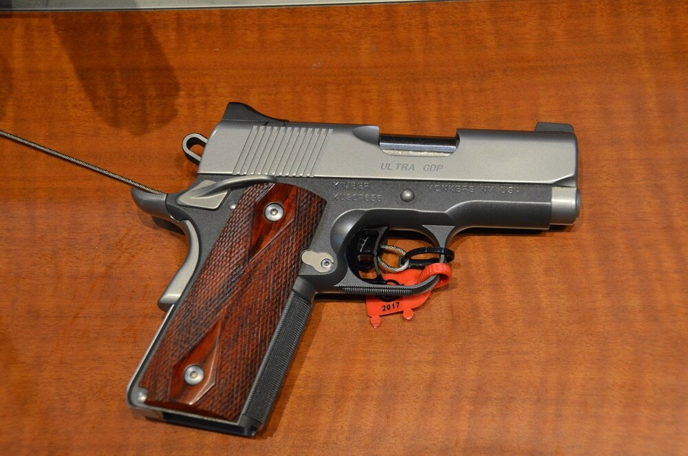 Kimber's new and very compact Ultra CDP (Custom Defense Package) is available in .45ACP ($1,173) or 9mm ($1,194) and features a flush-cut barrel, extensive carry melting, aluminum frame and rosewood grips. Weight is just 25 ounces.