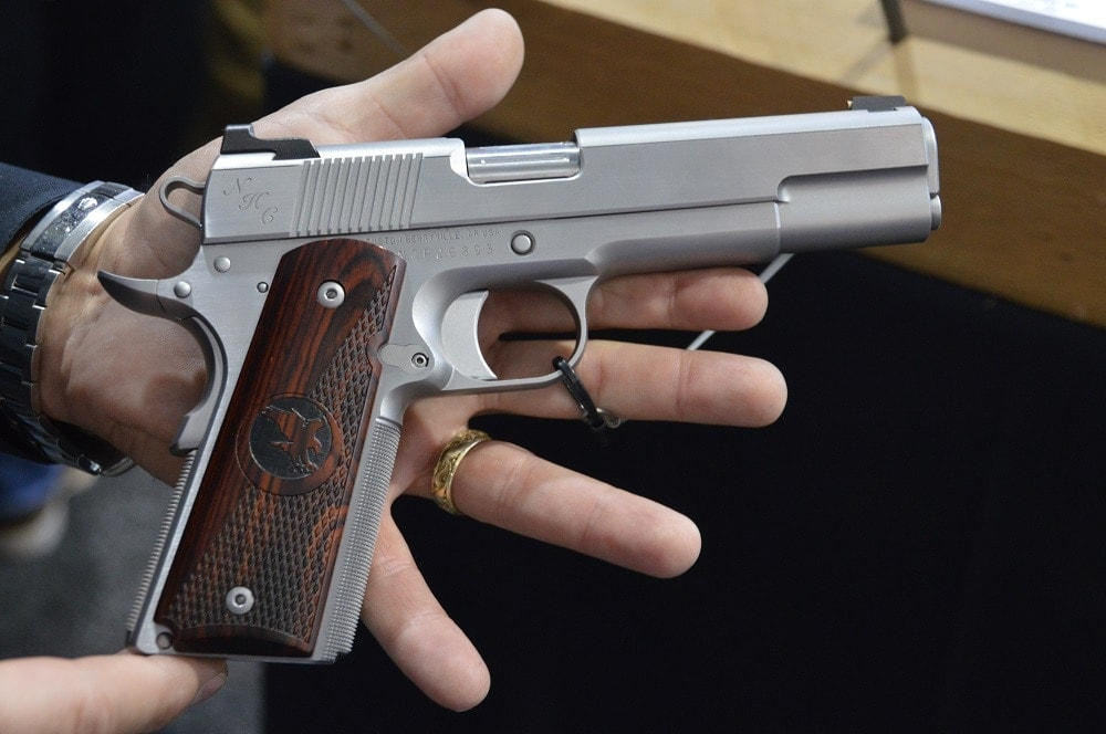 The new NHC Classic, another Guild gun, has a flattened top slide with a French Border and script engraving. MSRP $3,895