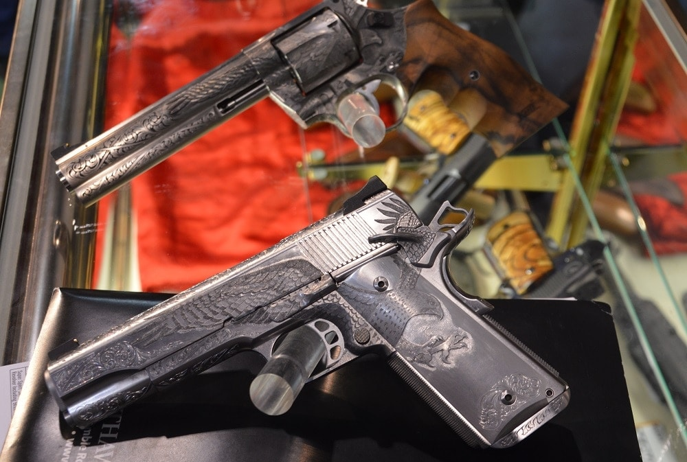 The 1911 is paired with a Korth revolver that has been similarly treated