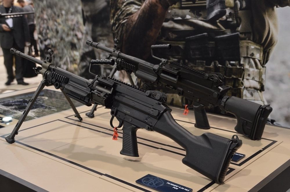 The updated FN Minimi Mk3-- slightly different from its M249 brother-- along with it's 7.62x51mm variant which has been replacing the classic FN MAG 58 with overseas clients.