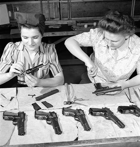 Final assembly of High Power pistols for issuance to Allied forces under a Canadian Mutual Aid Board contract at the Inglis factory, 1945. Note the Maple Leaf on the front of the grip